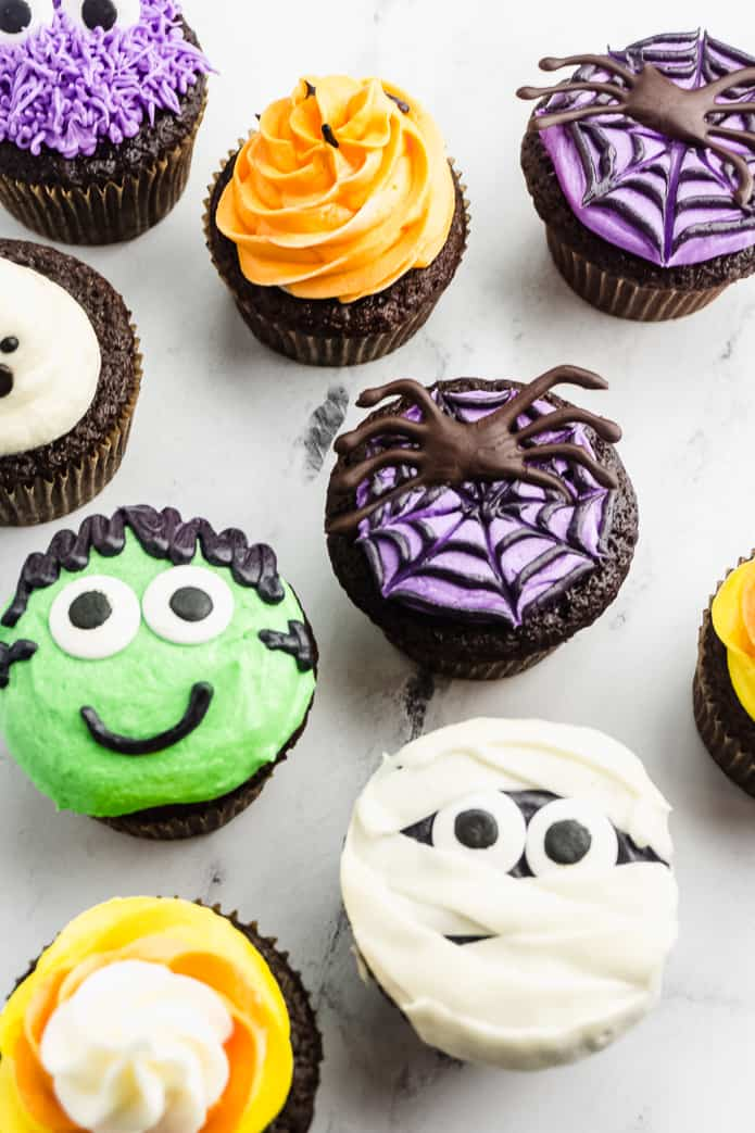 Cute and Easy Ghost Halloween Cupcakes are the perfect sweet treat or dessert to make for a Halloween party or take to the classroom. Easy to make with only a few ingredients!